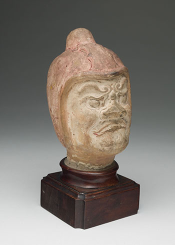 Chinese Painted Earthenware Head of a Guardian, Tang Dynasty (618-907) by  Chinese Art